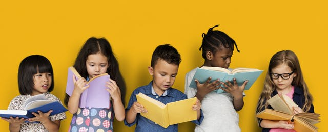 Five Kids Leaning on Wall Reading Books