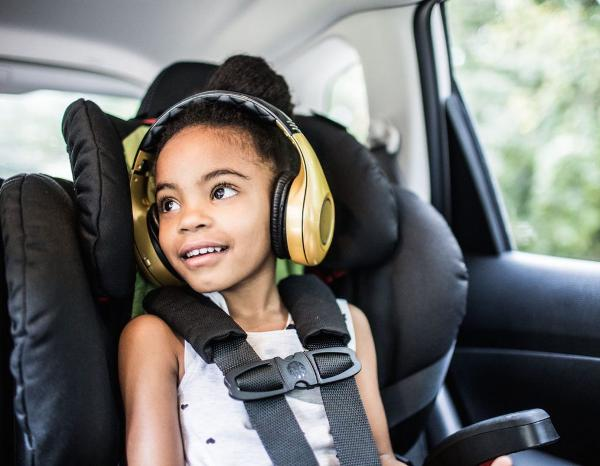Happy Black Girl Listening to Audiobook in Car