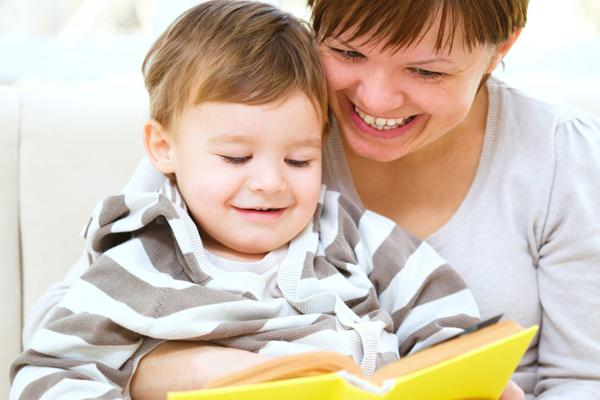 Mom Reading a Yellow Book to Child