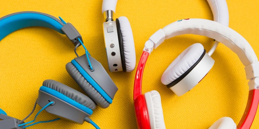 Three Kids Headphones Grey, White, Red Colors Photo