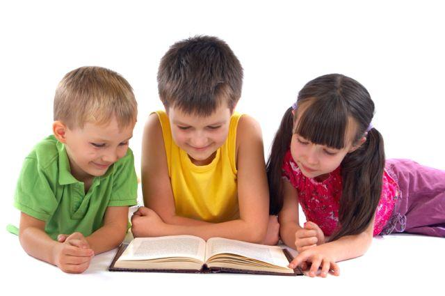 Three Kids Reading Children's Book Laying on Floor